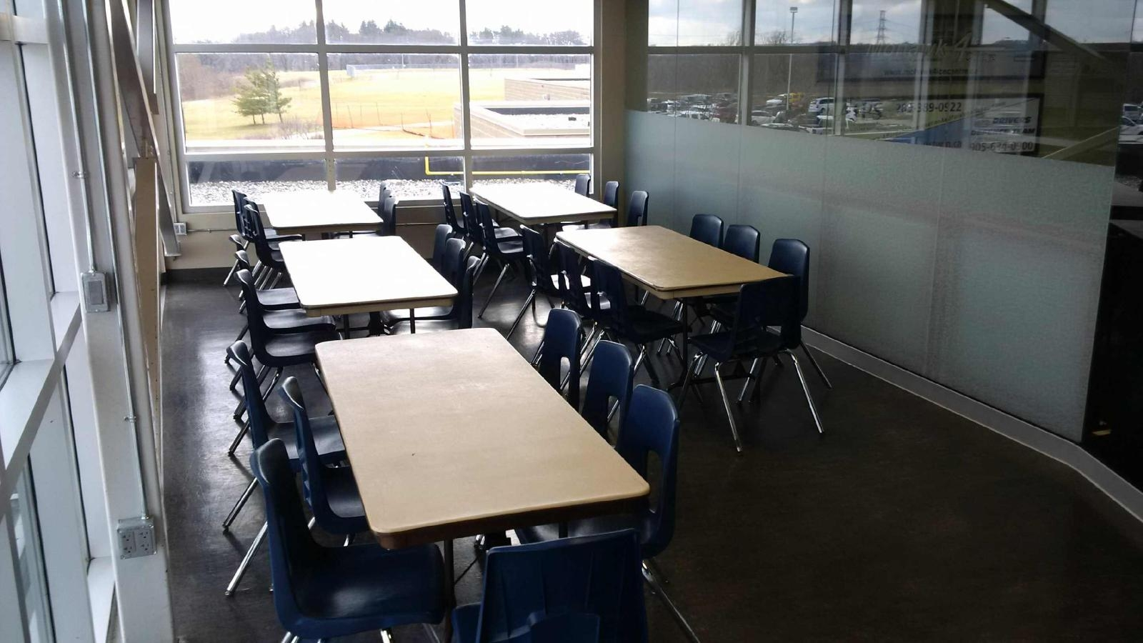 Cafeteria-style seating for 32 -- great for team parties/birthday parties.  Space for buffet table near entrance (unseen).